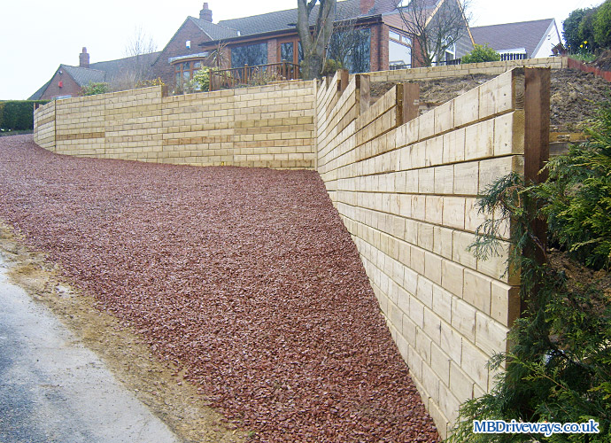 fence, fencing, wall, gravel, gravelling, red gravel, retaining wall